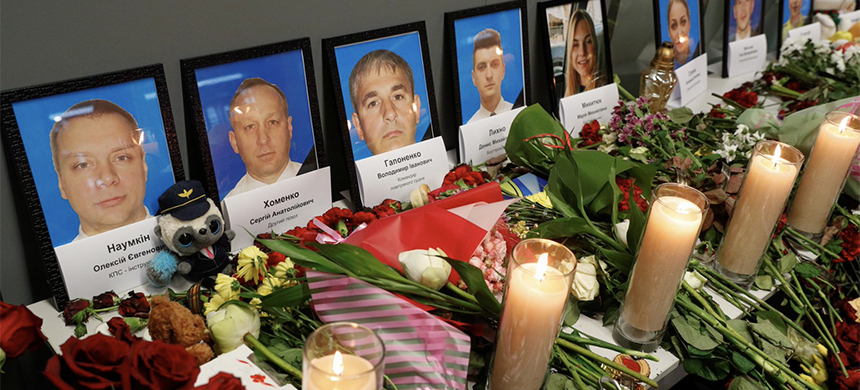 Flowers and candles are placed in front of the portraits of the flight crew members of the Ukraine International Airlines Boeing 737-800 plane that crashed in Iran, at a memorial at the Boryspil International airport outside Kiev, Ukraine January 11, 2020. (photo: Valentyn Ogirenko/Reuters)