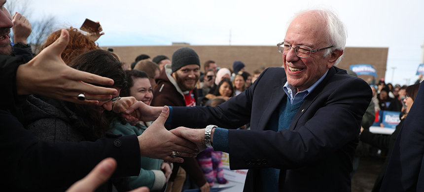 Vermont Sen. Bernie Sanders greets people at a campaign field office in Cedar Rapids, Iowa. (photo: Joe Raedle/Getty Images)