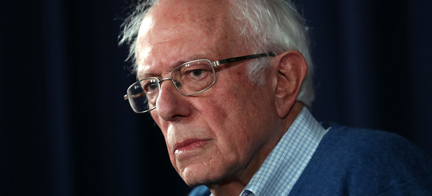 Democratic Presidential Candidate Sen. Bernie Sanders looks on during a press conference at his New Hampshire campaign headquarters on February 6, 2020 in Manchester, New Hampshire. (photo: Justin Sullivan/Getty Images)