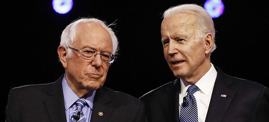 Bernie Sanders, left, and Joe Biden chat before a Democratic presidential debate in Charleston, S.C. (photo: AP)