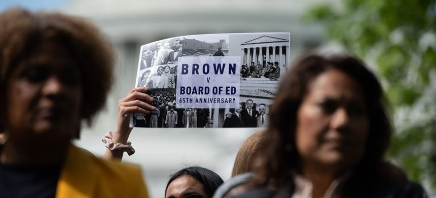Near the Capitol in Washington, people attend a rally in 2019 to mark the 65th anniversary of the Brown v. Board of Education ruling that ended public school segregation and fueled the civil rights movement. (photo: Nicholas Kamm/Getty)