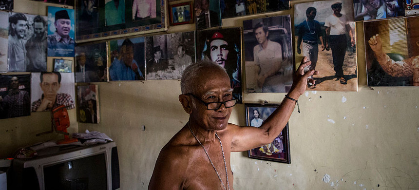 Eko Soetikno, 75 years old, points his photo with Indonesian writer Pramoedya Ananta Toer when was imprisoned in Buru island at his house on May 4, 2016 in Kendal, Central Java. (photo: Let Ifansati/Getty)