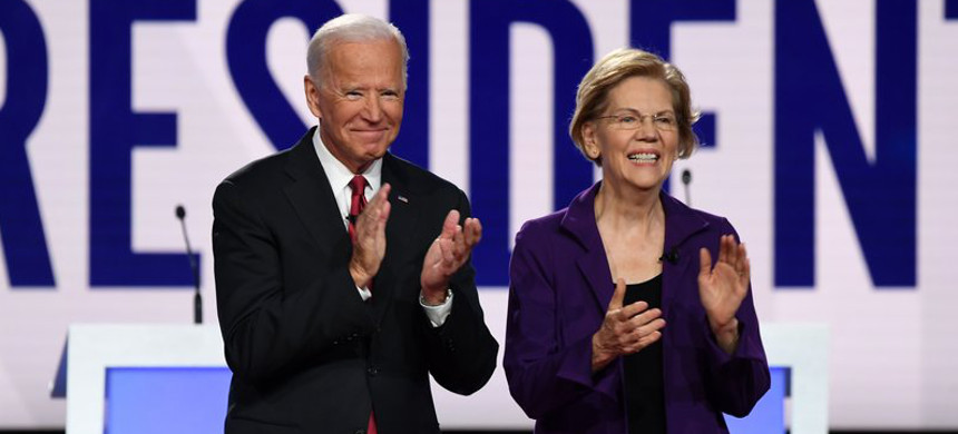 Former Vice President Joe Biden and Massachusetts sen. Elizabeth Warren appear before a Democratic primary debate in Ohio last year. (photo: Saul Loeb/Getty)