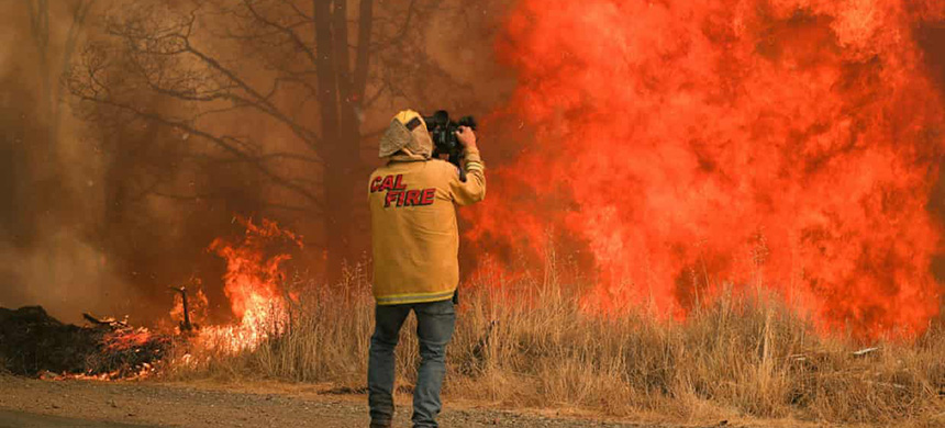 Tim Walton, an NBC News cameraman, covers the LNU Lightning Complex fire in Lake county, California, on 23 August. (Photograph: Adrees Latif/Reuters)