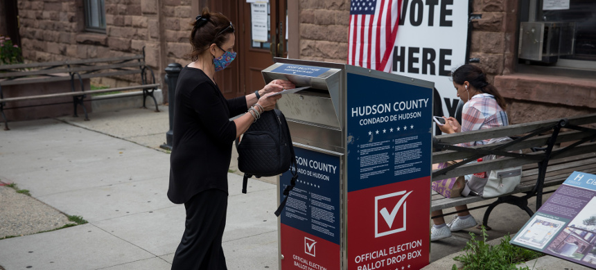 A voter drops a ballot at a mail-in ballot drop off box location in Hoboken. (photo: Michael Nagle/Bloomberg)