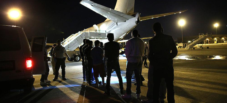 Undocumented immigrants wait to be loaded onto an Immigration and Customs Enforcement charter jet. (photo: John Moore/Getty Images)