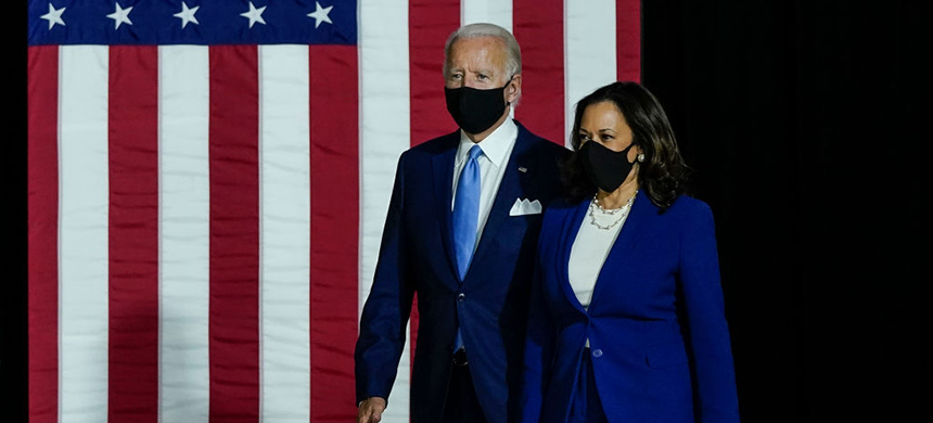 Joe Biden and Senator Kamala Harris deliver remarks on August 12, 2020, in Wilmington, Delaware. (photo: Drew Angerer/Getty Images)